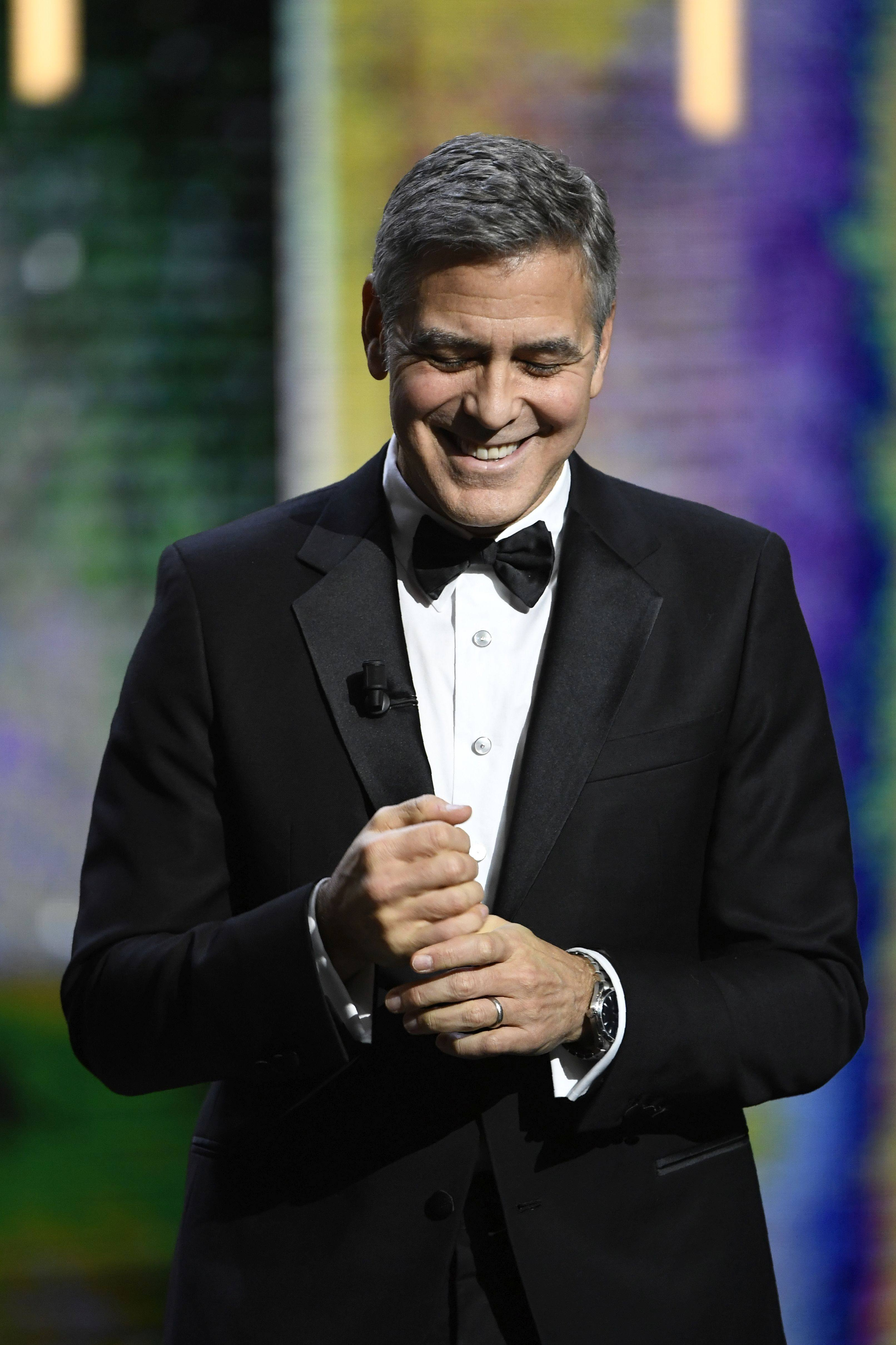 US actor George Clooney arrives on stage to receive an honorary award during the 42nd edition of the Cesar Ceremony at the Salle Pleyel in Paris on February 24, 2017. / AFP / bertrand GUAY (Photo credit should read BERTRAND GUAY/AFP/Getty Images)
